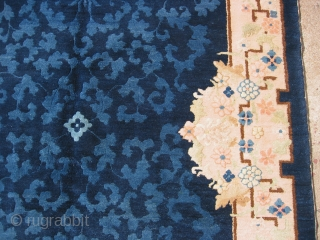Art Deco Chinese rug, hand knotted wool, China, c.1930's, dark navy or midnight blue with a blush pink border, Prussian blue and pale sky blue scrolling floral designs, pale pastel lavender, rose,  ...