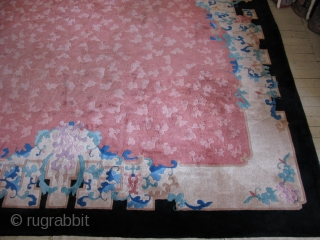 Antique Art Deco Chinese rug, hand knotted wool, China, ca.1930, tone on tone rose / pink all over floral with a cream inner border and a black outer border, this rug has  ...