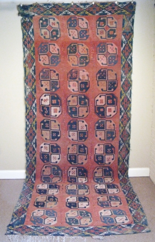 Uzbek Lakai Kilim, hand woven wool and silk, plain weave tapestry squares embroidered with wool and silk, and sewn together, early 20thC, the rug has problems, including color run, stains, fading of  ...