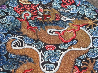 Antique Chinese nobility insignia badge, from a robe or coat, China ca.1900, hand embroidered silk and couching of metal threads, a left facing 5 claw striding dragon on a blue-black field, the  ...