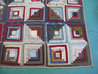 Antique American log cabin quilt, early 20thC with 19thC fabrics, some wild colors like crazy quilts of the period, an optical pattern that changes to squares or diamonds, depending on how you  ...
