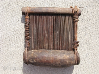Vintage African loom beater for narrow strips of fabric, Baule People, Cote d Ivoire, hand made wood and metal bound with hide, this is a used item with signs of use, the  ...