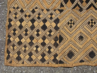 African Kuba raffia cloth, a waist wrap around dress, hand woven palm fiber, a field of cut-loop pile embroidery and flat stitch embroidery, the technique produces what is known as kasai velvet,  ...
