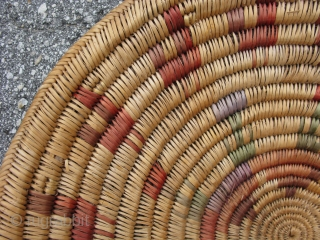 Semi-antique Native American Jicarillo Apache basket, hand coiled using the 5 rod coiling method, herringbone rim finish, brightly colored with aniline dyes that have faded, a six pointed star in the center,  ...