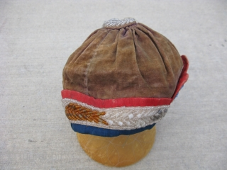 Antique Iroquois beaded hat, round velvet cap with beaded tassel on top, late 19thC, Eastern Great Lakes, USA or Canada, about 8 inches across and 4.5inches deep when worn, faded textiles, missing  ...