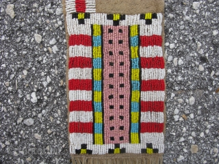 Cheyenne pipe bag, Great Plains Indians beaded bag, sinew sewn polychrome glass beads on hide, first half of the 20thC, the bead work is sewn in the fine Native American technique, where  ...
