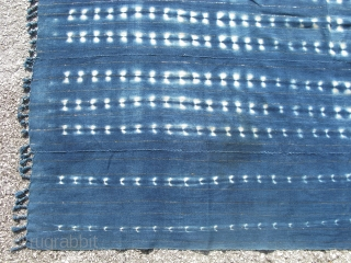 Vintage African indigo cloth, hand woven cotton with small stripes of gold synthetic material, hand dyed with natural indigo, the design is created by the resist dye method, hand tied fringe on  ...