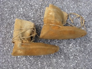 Antique Metis moccasins, Canada, ca. 1st QTR 20thC, the body is hand sewn with sinew threads, the the faceted glass beads are hand sewn with commercial thread, some soiling from use, there  ...