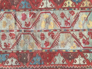 Late 19th century melas. Pretty range of colours. Great inner border. Cute design. edges secured. Sadly quite a lot of repiling of the delicate blue in the centre of the field and  ...