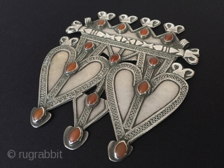 Central-Asia Turkmenistan-Ersary two heard asyk silver pendant with cornalian original ethnic turkmen jewelry Best condition  Circa-1900 Height ''14.5'' - Width ''12.5''cm - Weight :203 gr Thank you for visiting my rugrabbit  ...