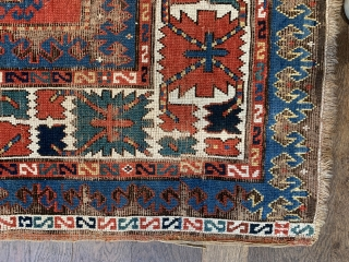 Pre commercial kazak probably mid 19 c with unusual design and the saturated natural dyes we would expect from that age.  Size 232 x 136. Hand washed old repairs to corroded brown  ...