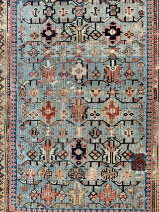 Early shirvan rug with powder blue field and Kufic border ca 1820 one old patch and darning to the corroded brown  Not many rugs  this old on the market.    ...