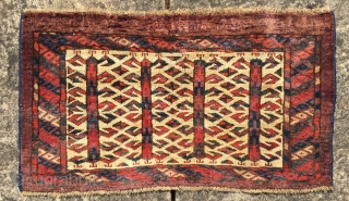 Wonderful Yomud Kap mid 19 c in very good original condition with all wool construction and natural dyes. Size is 63 X 38 cm. The dark aubergine ground has lines of abrash  ...