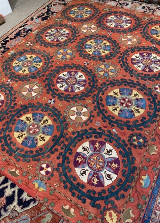 A large antique Suzani embroidery on red cotton ground ca 1880 size 256 x 191 cm Professionally backed some details fuchsine unusual and decorative
