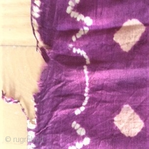 Ceremonial plangi from Bali, very fine silk fabric with beautiful coloures in red/violet and yellow /orange. It is a part of a festival dress for woman, about 20th centery. The thin fabric knows some  ...