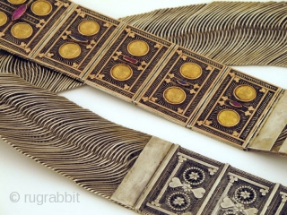 Antique Silver Belt from Kerala. This massive beauty is typically worn by the Muslim Women of Kerala. A kilo of fine silver with the addition of gold tokens and jewels. The gold  ...