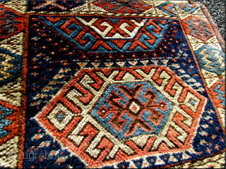 A SANJABI KURD CHUVAL.  The main field design as well as the border design is bigger, bolder, and more distinct then most I have seen. I believe it is from the  ...