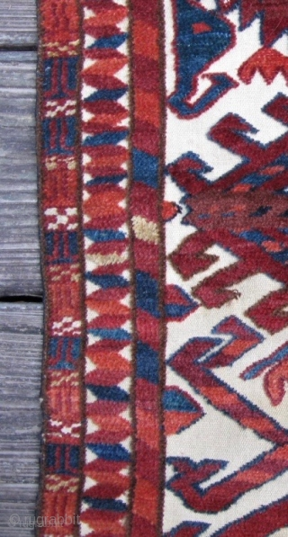 19th century Turkmen tent band fragment. How about those two large distinct Botehs which are closely aligned with Beshir's and Kirghiz rugs (similar to the picture clip I added to the end)  ...