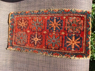 The pile on this Kurdish bag face has such a patina that when seen at a certain angle and light makes it appear magnificent. There is a gorgeous deep aubergine.The blueish stars  ...