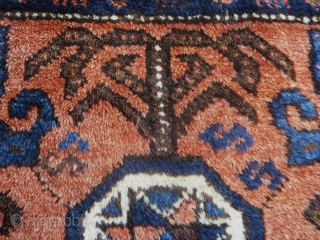 Unusual and early Baluch bag face. It is very meaty and thick with a soft voluptuous pile. The dark blue field color is super saturated. It does not have the typical octagons  ...
