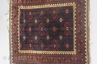 Square antique Baluch bagface with silk. I do not recall seeing bags with this  design having a running dog border nor could I find any in my library. Measures 2.3 inches  ...