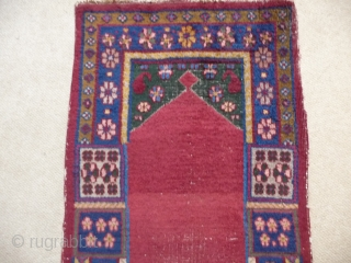 KHOTAN ;  An unusual Khotan prayer rug, complete and in reasonable condition. SOLD