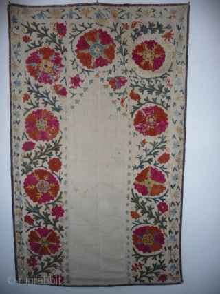 A very pretty small prayer suzani, 4ft5in x 2ft9in.,late 19th cent., embroidery a little rubbed at the top,slight run from the cochineal in a couple of flowers, sound with attractive printed backing,water  ...