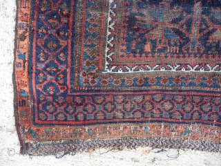 An ancient and venerable blue field Timuri prayer rug. Inky black field with polychromatic light blue and green. Low pile faded old repairs etc. Beautiful old rug. 4ft10ins. x 4ft