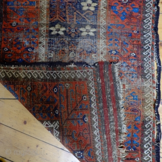 An early Mina Khani Persian Baluch Rug  Size 215 x 91 cm In distressed fragmented condition with wonderful colours, including an electric blue and aubergine brown and dating from the mid 19th century.  ...