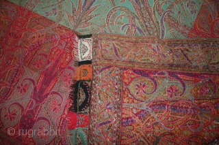 A 19th century Indian cashmere shawl....very nice condition with very nice colors.....