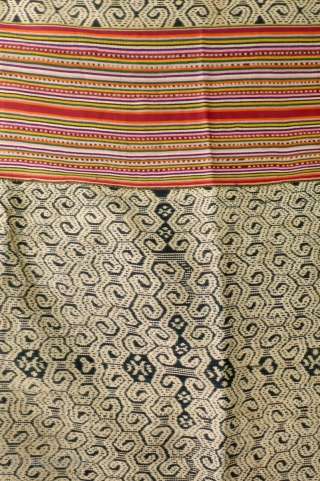 Large  men's wrap cloth, selimut, Insana/West Timor, Indonesia, mid 20th century, Ikat, commercial yarn, handwoven. Three panels, centre covered with very intriguing spiral motif, two colourfull striped panels   enclosing  ...