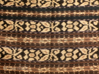 Tubular women's skirt, sarong, Savu, Indonesia  second half 20th century  Handwoven traditional ikat, commercial cotton yarn, natural dyes, two panels,  layout in stripes relates to the descent group ei worapi, main motif stripe: flowers in  ...
