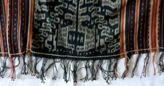 Cover, selimut, Miomafo/West Timor/Indonesia, ca. 1970 Rectangular cloth, three panels, traditionally wrapped around shoulder or hip by men, fine handspun cotton, natural dyes, layout symmetrical warp stripes, some with small ikat pattern,   ...