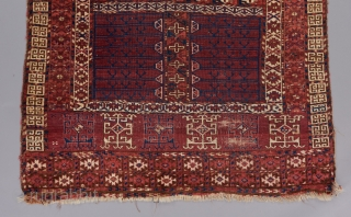 An early Ensi. Kizil Ayak or something of the sort. Cotton highlights. Asymmetrically knotted open right. 5' x 4'.