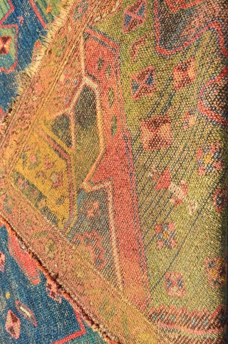 """Kurdish rug. 7'3"""" x 4'2"""". Areas of wear and some glue on the back."""