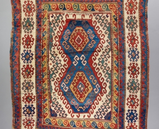Bold Kazak with superb color and very good age. Much of it in fluffy sumptuous pile. Cut and sewn back together in a few places but only missing a very small amount  ...