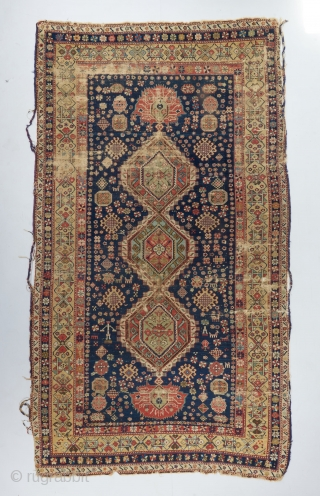 """An early Karagashli with a rare and beautiful main border. Needs a wash. Condition issues as visible. Resewn together in one spot but missing next to nothing because of it. 8'2"""" x  ..."""