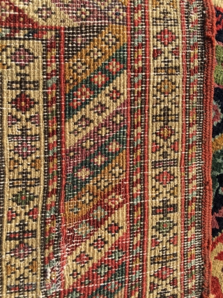 Mid 19th century northwest runner . Spectacular colors . Wool warps and cotton wefts. Cut at one end . A few small tears . App. 10' x 3'.