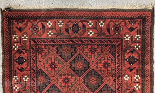 Baluch rug with a dignified presence . Precise drawing and very good color. Good condition with some wear and corrosion.