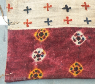 Antique Large Tibetan Saddle Blanket. 60 x 40 inches. Attractive front is tye-dyed handloomed heavy thick wool fabric, with attractive pattern throughout, backed with thick wool material and padding material between the  ...