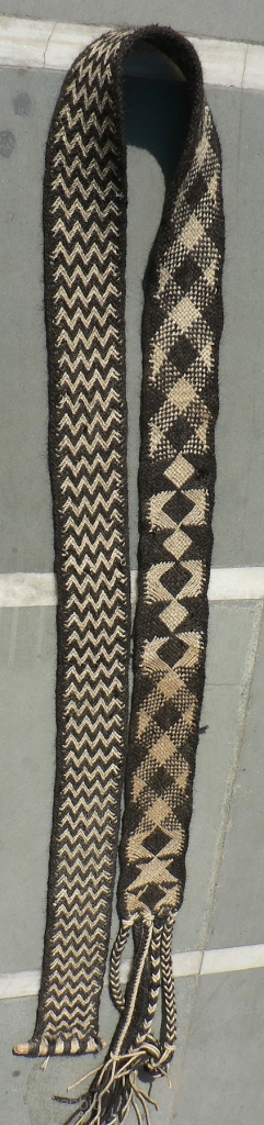 Old Camel Girth Band from the Thar Desert Region in Rajasthan, India. The band is 4 inches x 102 inches (not including the 12 inch tassels) woven from goat hair. These types  ...