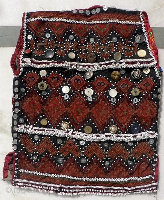 Indus Kohistan Child's Vest. Finely embroidered in tiny cross stitch and flat stitch, with intricate beadwork, baubles and buttons, demonstrating the mother's skill and love for her young child.  Early to  ...