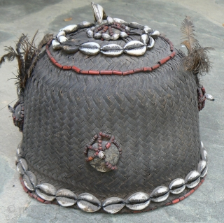 Old Naga Cane Woven Hat, from the state of Nagaland in NE India, probably Konyak, with lots of decorations, including boar tusk, glass beads, cowrie shells, sea shells, wood, bone, and feathers.  ...