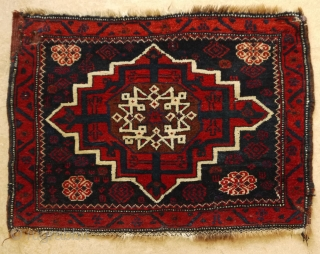 Star medallion bagface, Kirman area, Afshar Baluch.   Beautiful deep warm colours, condition is good, but there is one 'restauration' at the left side. 81 x 57 cm.