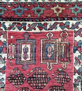 The King of Kurdish funk!!! This is such a cool, funky and graphic rug. A real village weaving. Varies from full chunky pile to a bit lower, with some moth damage on  ...