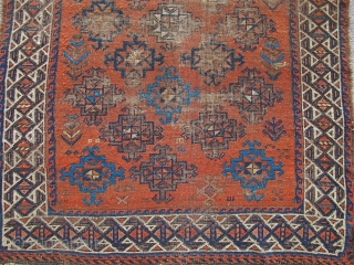 Baluch with stary field on an ochre ground. Looks like it should be symmetrically knotted but it is asymmetric open left. Beautiful spacing and placing of ornament. Traces of striped kilim on  ...