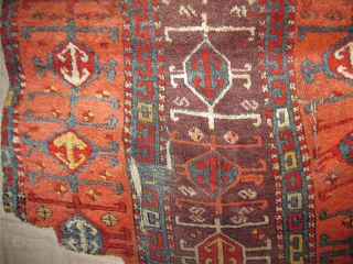 East Anatolian Kurdish Rug, Great Colors, especially the purple ground, Great Wool, blue wefted with traces of brocaded ends at the bottom. Great graphic quality. Very good age, fragmented and mounted. There  ...