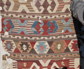 """Antique Central Anatolian kilim fragment, mounted and conserved, nice graphics and weave. 33"""" x 108"""". Traces of purple 'mosque ink'."""