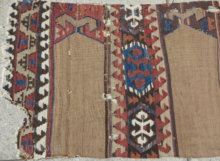 "Central Anatolian kilim with camel ground niches. Probably too narrow to be a saf but gives that impression graphically. 26"" x 94"""