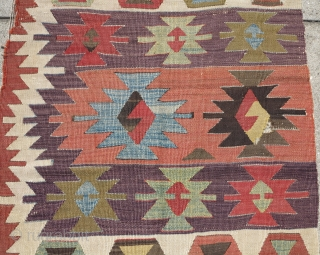 "Central Anatolian kilim with ashik-like devices and very nice colors including modeled greens and blue and a fantastic aubergine. Graphic serrated side border. Good age, size is 28"" x 115"""